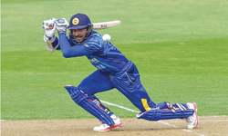 Record-breaker Sangakkara sets up facile win for Sri Lanka