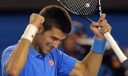 Djokovic masters Wawrinka to reach Open final