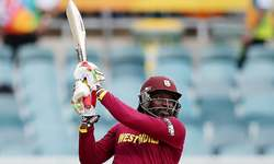 Gayle rewrites record books