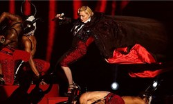 Madonna's unscripted plunge steals show at Brit awards