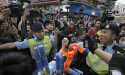 33 held after anti-mainland march in Hong Kong