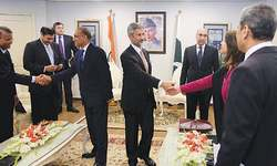 Pakistan, India vow to work together