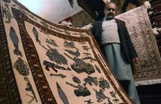 From AK-47s to drones, Afghans 'war rugs' reflect bloody decades