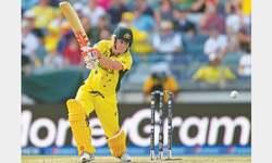 Warner dazzles as Aussies wallop Afghanistan