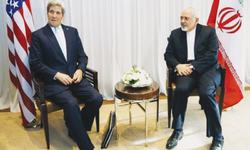 Kerry in new Iran talks as US political storm rages