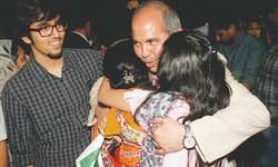 Joyous welcome for rescued Pakistani families