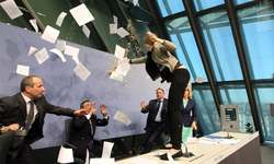 ECB, hit by lone protester, pledges to keep cash floodgates open