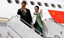 Go Green: The Chinese first lady's style screams brotherhood