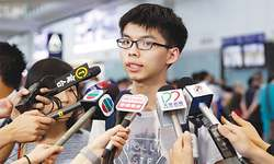 Malaysia refuses to let in teen leader of Hong Kong protests