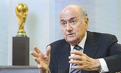 Calls for FIFA's Blatter to quit as global anger builds