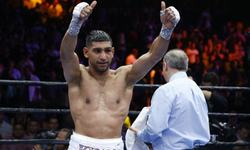 Khan calls out Mayweather after unanimous decision win over Algieri