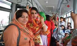 Packed like sardines, joyriders go sightseeing on the red bus