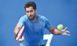 Aisam, Muller ease into second round