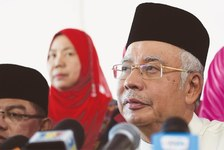Malaysian leader faces risk of criminal charges over investment fund
