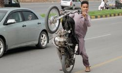 Dangerous tradition of motorcycle stunts continues