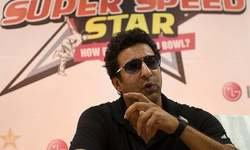 Bullet hits Wasim Akram's car in traffic incident