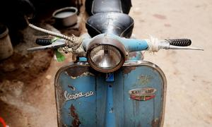 Vroom! Into the graveyard of Vespas we rode...