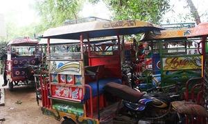 Qingqi rickshaw owners move SC against ban