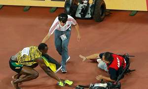 Cameraman takes down Usain Bolt after 200m win