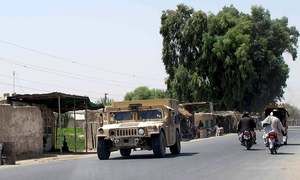 Afghan forces, with NATO help, attack resurgent Taliban