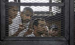 Egypt sentences three Al-Jazeera journalists to three years in prison