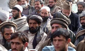 Afghan forces regain control of a symbolic district in Helmand