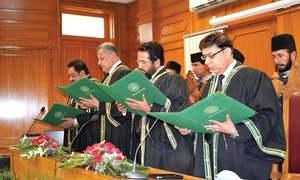 Three judges take oath