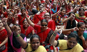 Millions go on strike  over 'anti-labour' reforms in India