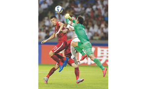 Son spurs Laos rout; HK hold China