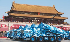 China announces troop cut, showcases military might