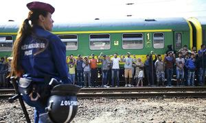 Standoff between refugees on train, police enters second day in Hungary