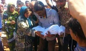 Father buries drowned toddler, family in Syria
