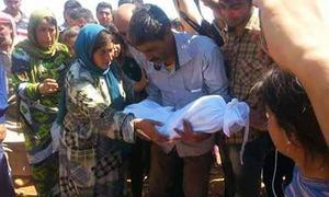 دنیا کو دہلا دینے والا شامی بچہ سپردخاک
