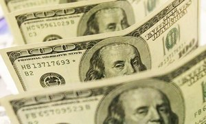 Dollar trading higher in interbank