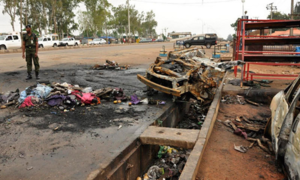 Women suicide bombers kill 13 in Nigerian mosque, govt residential area