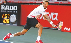 Nadal downs Pospisil to reach China Open quarters