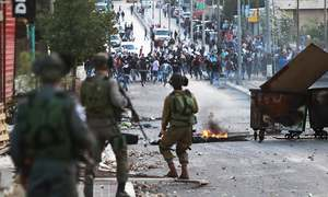 Israeli troops kill six Palestinians, unrest spreads to Gaza
