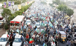 PTI, JI chiefs canvass support for LG polls with Karachi rally