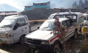 Official vehicles rusting away in Upper Dir