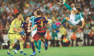 Barca beat Betis to remain top, Atletico keep up pressure