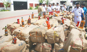 12,400 liquor bottles, cans seized at sea; six men held