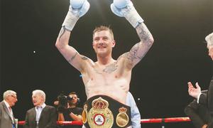 Burns becomes three-weight world champion