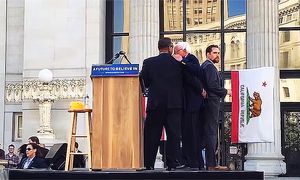 Secret Service agents secure Bernie as animal rights activists disrupt Oakland rally