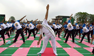 Millions stretch and bend as Indian PM Modi leads International Yoga Day exercises