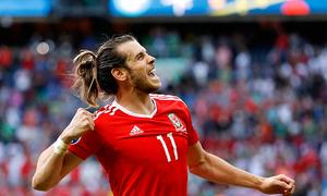 McAuley own goal sends Wales to Euro quarters in British affair