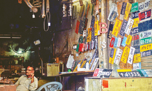 Too much on your plate? Karachi's booming fake licence plate business