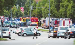 Six dead in Munich shooting; three suspects at large