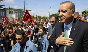 Erdogan shuts schools, charities in first state of emergency decree
