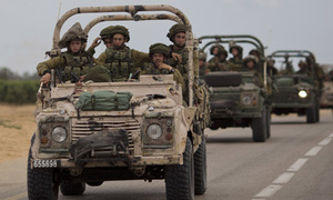 Israel hits Syria targets after stray fire on Golan