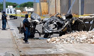 Twin suicide bombs kill 13 near Mogadishu airport